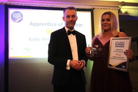 Kadie Wilkinson recieving the Apprentice of the Year Award - presented by Rob Barlow, East Lindsey District Council Chief Executive