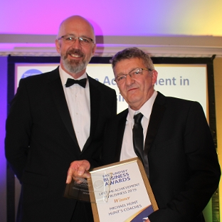 Michael Hunt collecting his Lifetime Achievement in Business Award - presented by East Lindsey District Council Leader, Councillor Craig Leyland